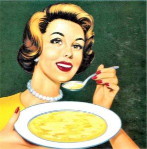 La signora del dado star: capelli cotonati rossetto rosso filo di perle e piatto di minestra